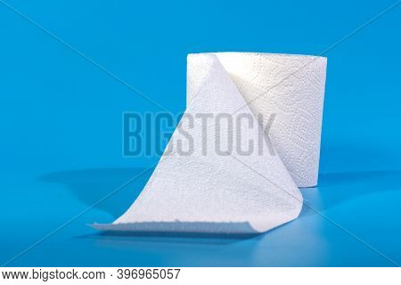 Toilet Paper. Roll Of Toilet Paper On Blue Background, One Toilet Paper Roll Isolated On Blue Backgr