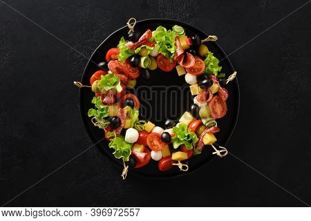 Christmas Food Wreath Of Holiday Snacks, Canapes, Tomatoes, Olives, Vegetables, Mozzarella Cheese Fo