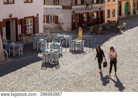 Sibiu, Transylvania, Romania - July 8, 2020: Small Street Terraces And Beautiful Girls In The Histor
