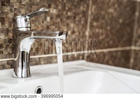 Open Water Tap With Running Water. Water Tap