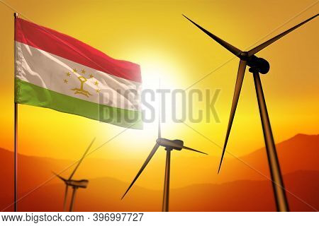 Tajikistan Wind Energy, Alternative Energy Environment Concept With Turbines And Flag On Sunset - Al