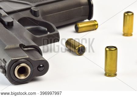 Traumatic Pistol Close Up And Several Cartridges On A White Background