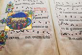 medieval folio with Benedictine chant notes for church service poster