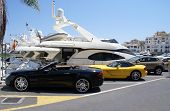 Luxury cars in the car park of the yacht club of Marbella Spain. Marbella is the luxurious area of the celebrities poster