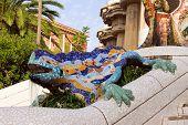 Sculpture of a Dragon salamandra of Antoni Gaudi mosaic in park guell of Barcelona poster