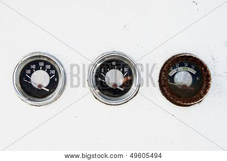 three rusty blank vintage guages with clipping path on white