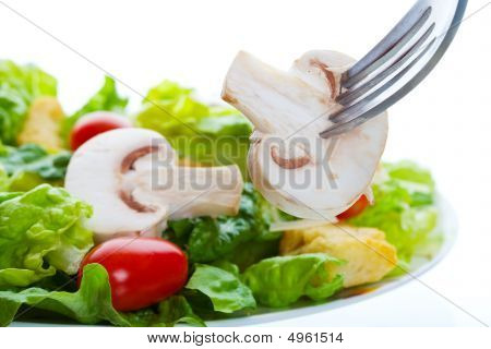 healthy salad appetizer with a raw mushroom on a fork poster
