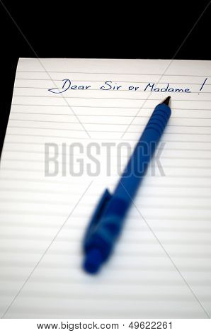 Dear sir or Madame writen on a notepad