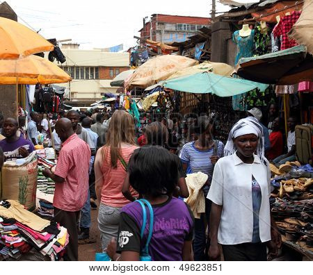 White Woman In African Market Shopping