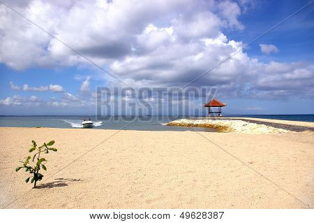 pictorial balinese beach with speed boat