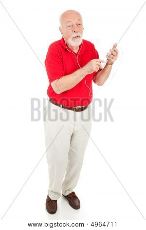 Senior Man With Mp3 Player - Full Body