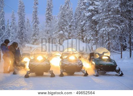 Snowmobile engine start on snow and ready to use in Kiruna Sweden