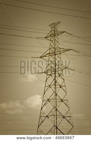 Pylon and transmission power line on sky background poster