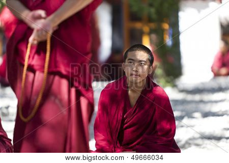 LHASA, TIBET- OCT 07: Tibetan monks are debating over Buddhist Scriptures at the Sera Monastery on October 07, 2011 in Lhasa, Tibet