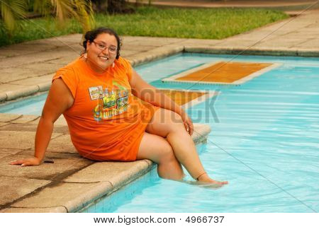 Overweight Woman By The Pool