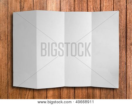 Blank Fold White Paper On Wood