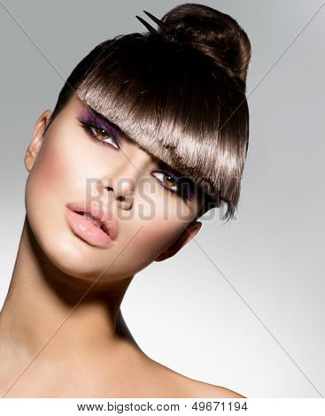 Fringe. Fashion Model Girl With Trendy Hairstyle. Haircut. Stylish Beauty Brunette Woman Face. Beautiful Make up. Vogue Style. Hair cut.