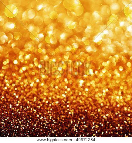 Fondo festiva de oro. Abstact parpadeante oro Navidad y año nuevo Bokeh con copys