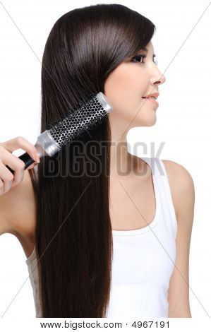 Woman Combing Hairs
