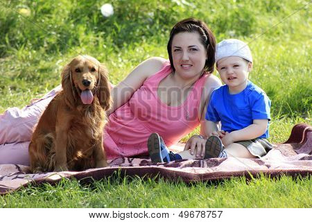 Mother, Child And Dog On Picnic