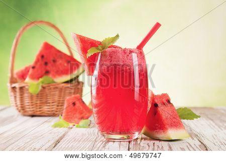 Fresh water melon drink on wood
