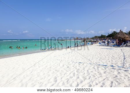 RIVIERA MAYA, MEXICO - AUGUST 9: People at the beach in RIVIERA MAYA on August 9, 2013, Mexico