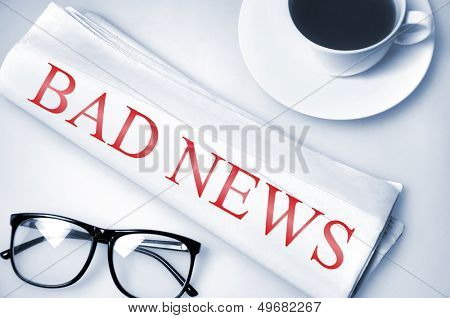 Bad news word on newspaper