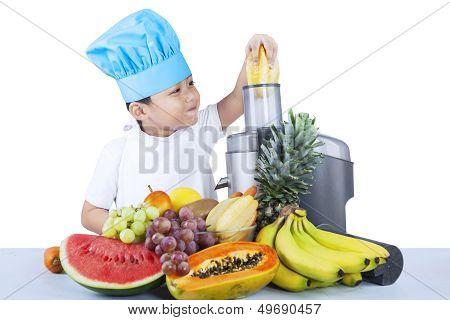 Cute Boy Is Making Fruit Juice