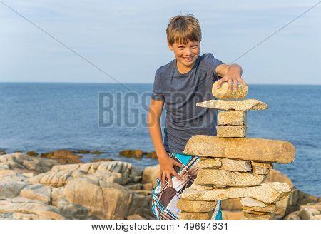 Boy Building Inukshuk