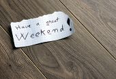Have a great Weekend - Hand writing text on a piece of paper on wood background with space for text poster