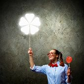 Funny teenager girl with candy. Luck idea poster