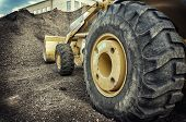 Bull dozer heavy duty construction site focus on large tire. poster