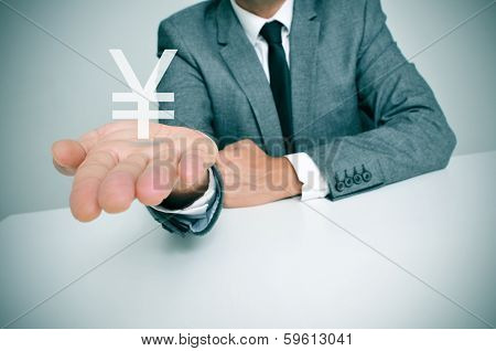 a businessman sitting in a desk showing a chinese yuan or japanese yen sign in his hand