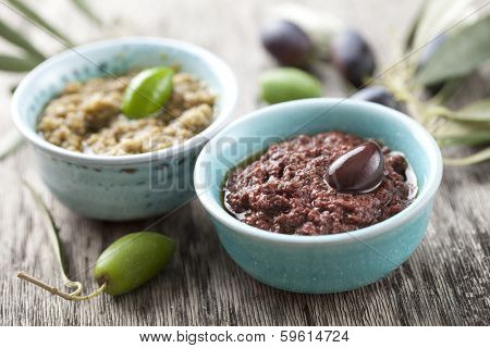 bowls with fresh olive paste made from kalamata olives poster