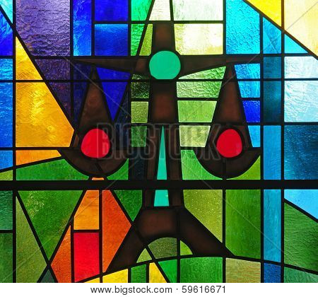 Stained glass window depicting scales of justice