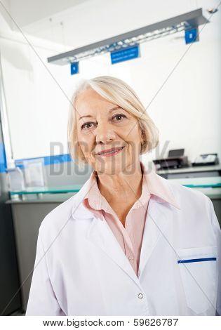 Portrait of female senior researcher smiling in hospital
