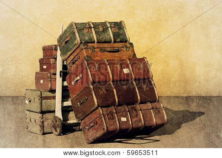 A Vintage Grunge Photograph of a Pile of Old Suitcases - Luggage