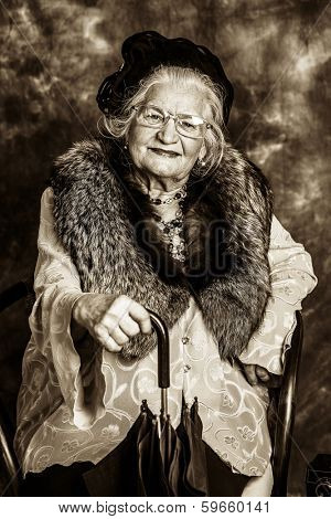 Portrait of a beautiful old lady in an elegant old-fashioned clothes. Vintage style.