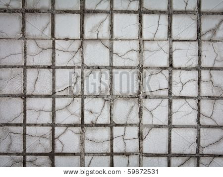 Aged ceramic tile mosaics, can be used as a background. poster