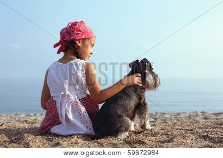 beautiful little girls embracing her dog