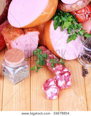 Lot of different sausages on wooden table close-up poster