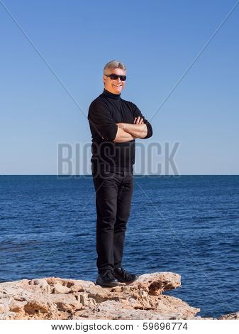 Smiling Handsome Confident Mature Man At The Seaside