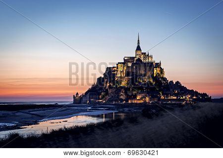 Mont Saint Michel, France.  Brilliant sunset colors.