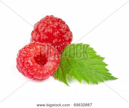 Red Ripe Raspberry With Green Leaf Isolated On White