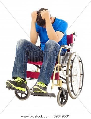 depressed and handicapped man sitting on a wheelchair poster