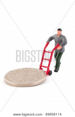 Minature Figure Moving A Coin Over White