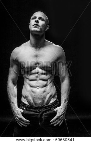 Muscle sexy naked young man with perfect sixpack posing in jeans
