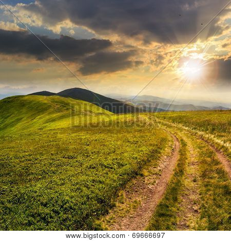 Path On The Mountain Top At Sunset