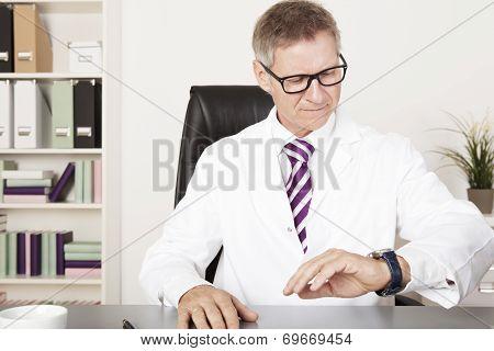 Male Physician Watching Wrist Watch
