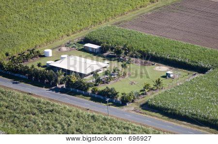 Aerial Of Farm House.